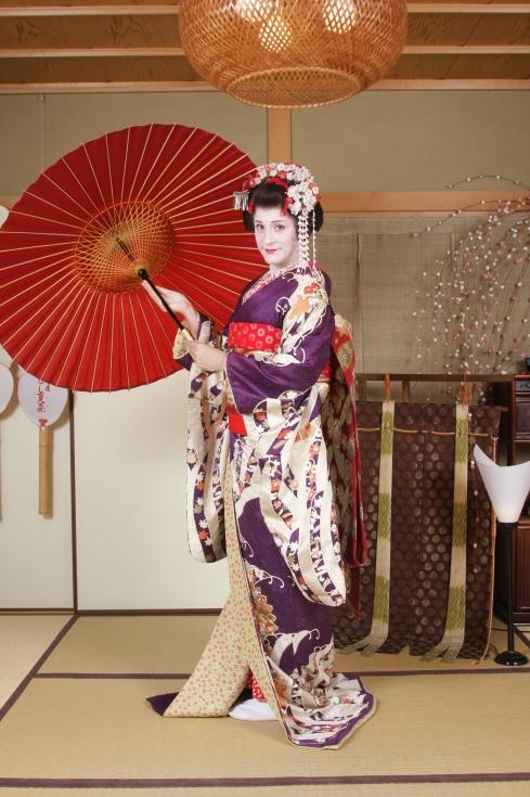 Maiko transformación con sombrilla
